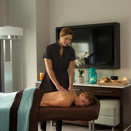 woman getting an in-room massage at Escape Spa