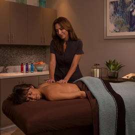 woman getting a massage at The Grove spa