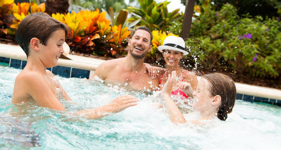 family playing in the hot tube at The Grove Resort & Spa Orlando