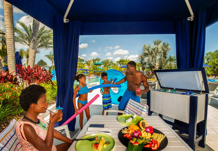 family in a private cabana at surfari water park