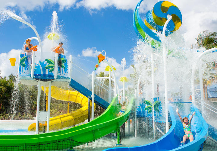 kids playing on water slides