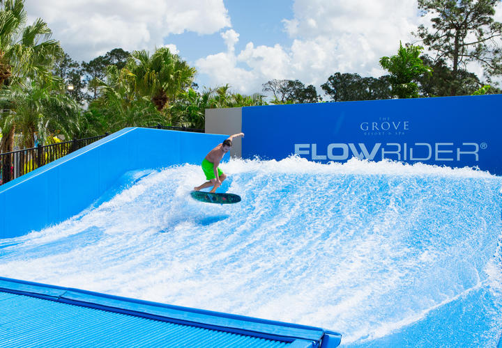 man doing tricks on the flowrider