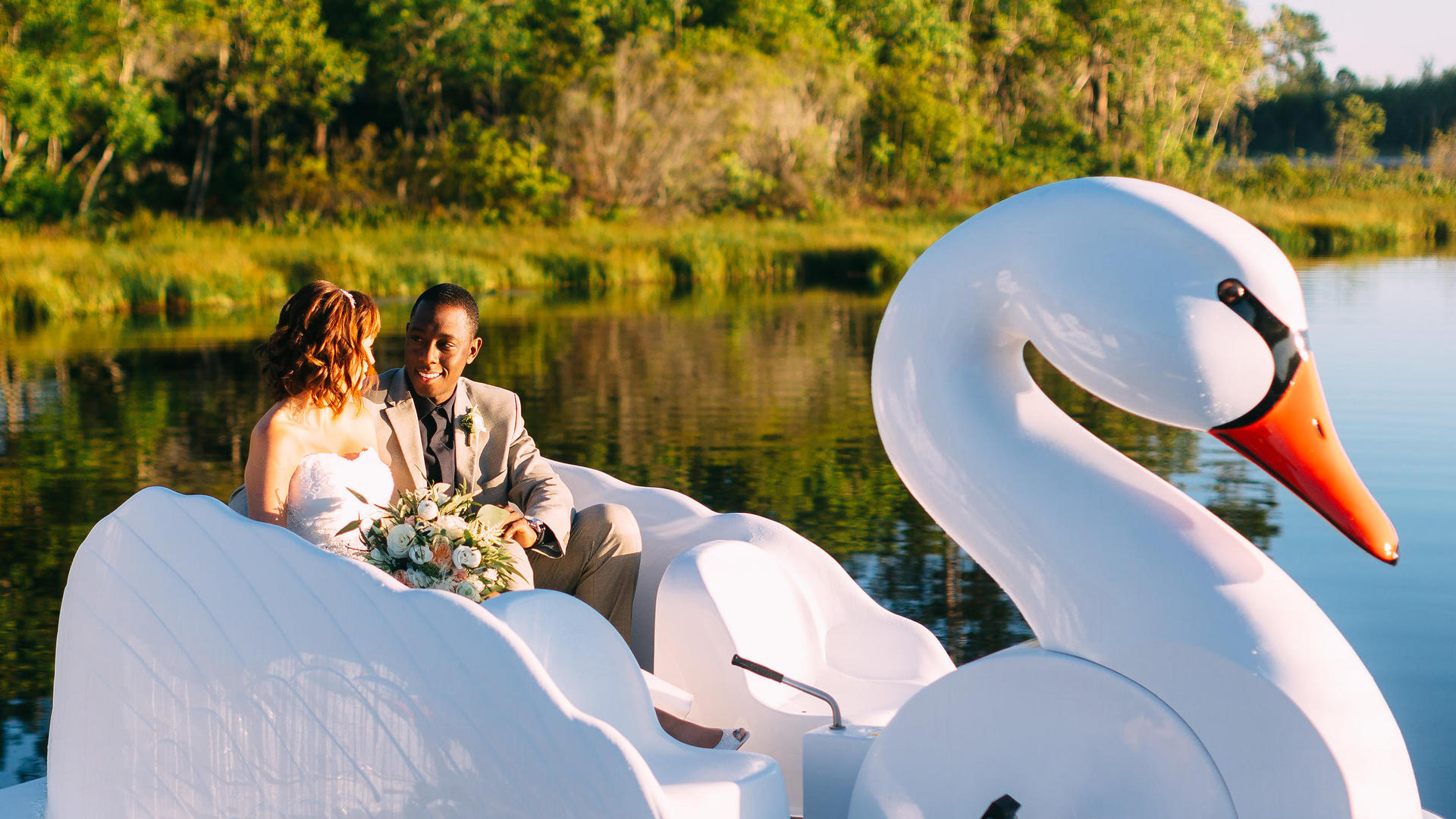 newlyweds on a swan boat