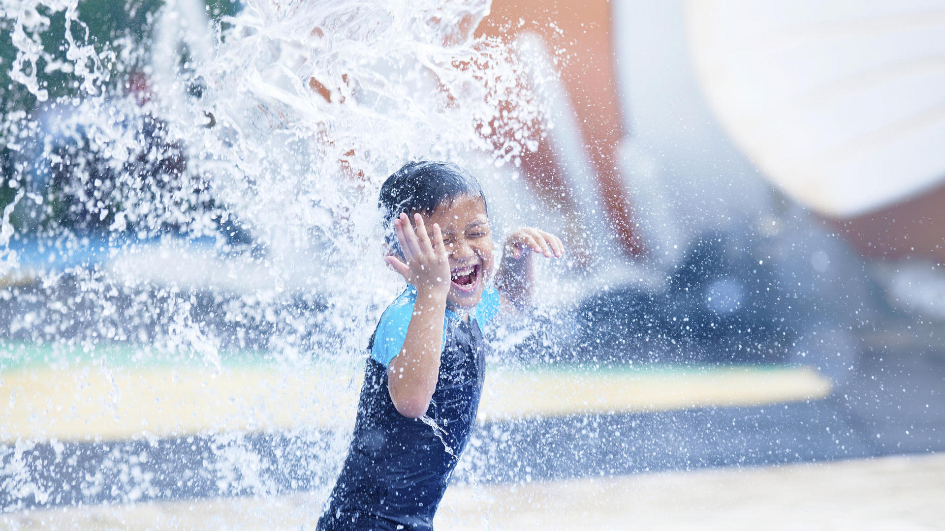 child splashing around