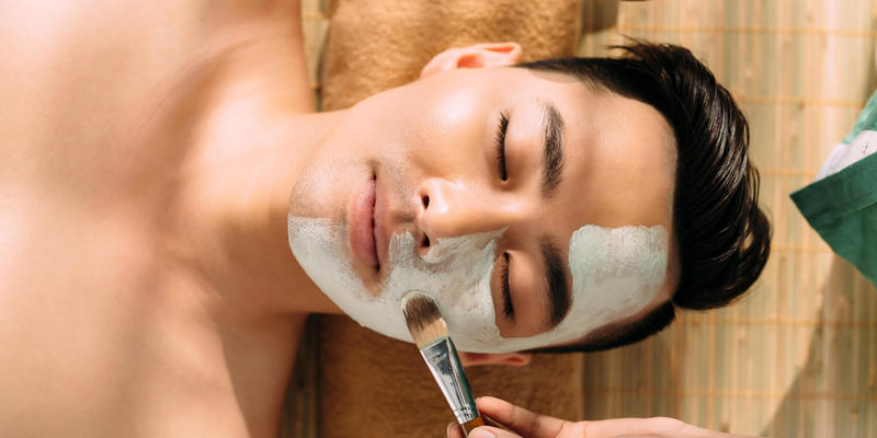 man getting facial treatment